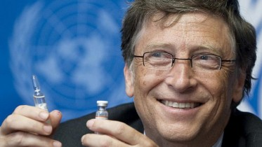 Bill Gates, Co-Chair the Bill & Melinda Gates Foundation shows a vaccine during the press conference. UN Photo / Jean-Marc FerrŽ